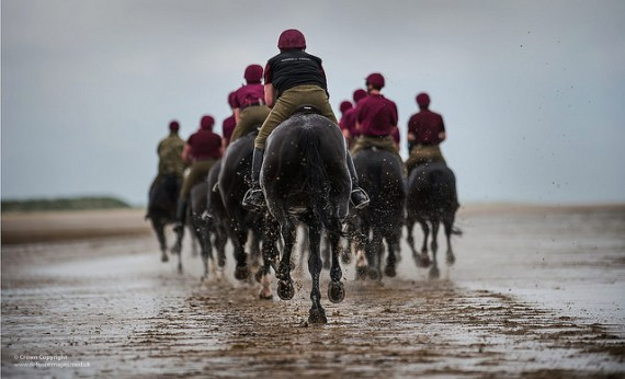 Horses of the Household Cavalry Mounted Division Exercising on the Beaches of North Norfolk - photo by Defence Images / Flickr
