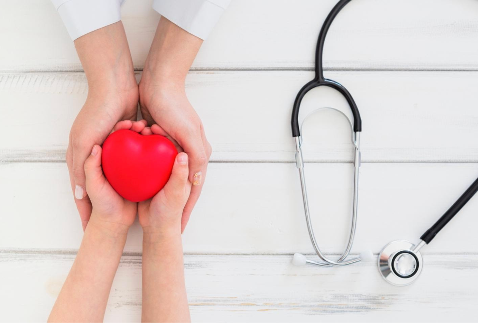 two hands holding a plush heart with a stethoscope nearby. MEDIjobs