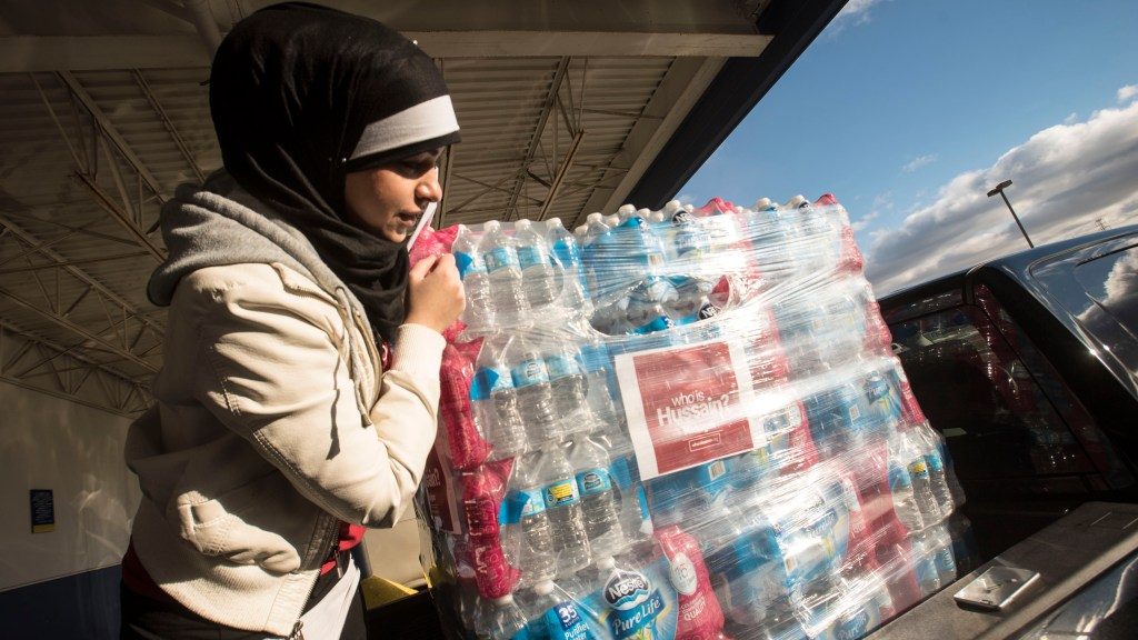 Who is Hussain Muslims providing water to Flint