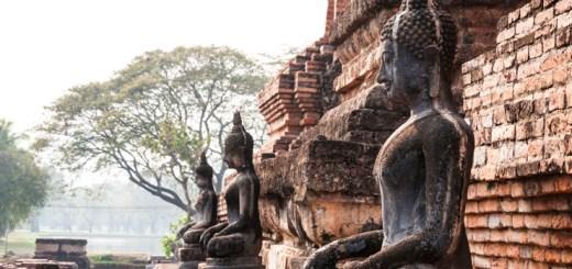 Ancient buddha statue at Sukhothai historical park , Thailand