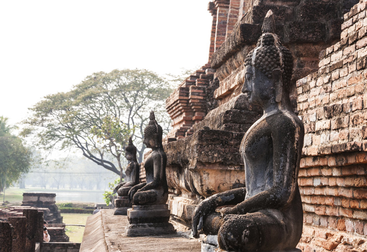 Ancient buddha statue at Sukhothai historical park , Thailand