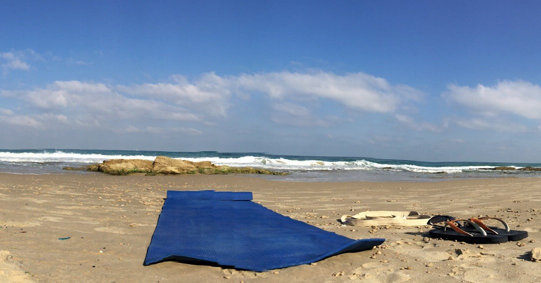 Yoga mattress lying on the beach