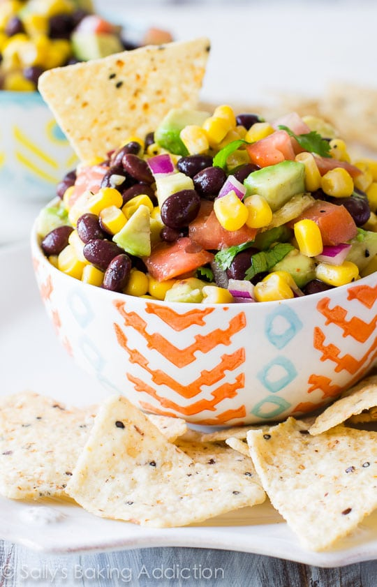 Fiesta Corn Avocado Salsa. Find this and more great summer potluck recipes here.