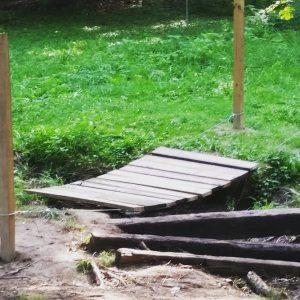 Building a swinging bridge across the creek in our yard.