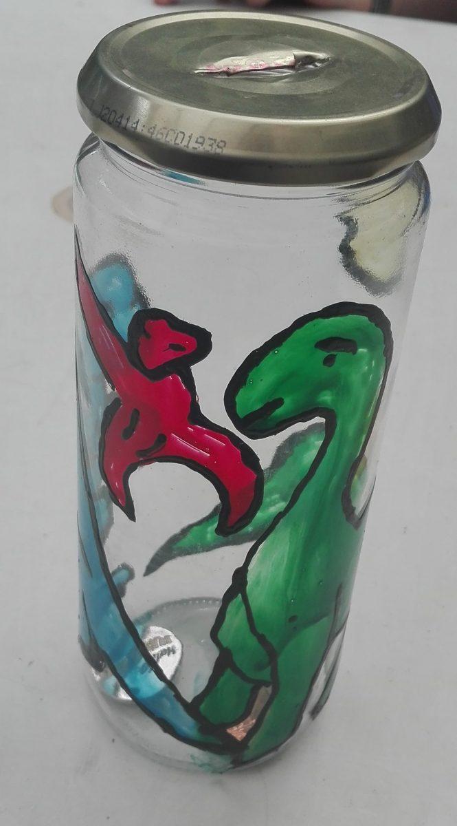 dinosaurus spaarpot van een glazen pot
