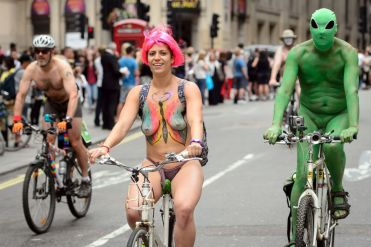 Cyclists take part in the annual World Naked Bike Ride in central London on June 14, 2014, to protest against car culture and to raise awareness of cycling as an environmentally friendly option. The World Naked Bike Ride (WNBR) is an initiative that takes place in over 50 cities around the world. AFP PHOTO / LEON NEALLEON NEAL/AFP/Getty Images