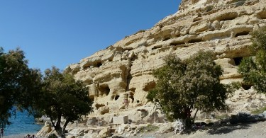 Matala, a village that lives with its sandstone caves