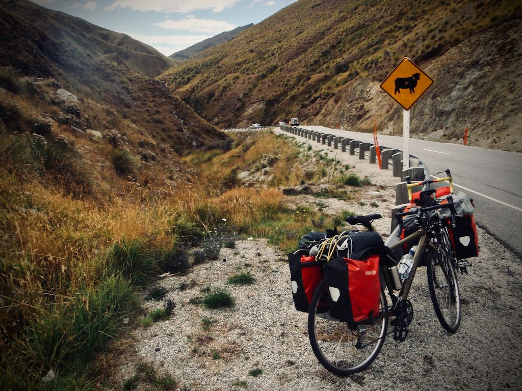 Bicycling by the side of a mountain road