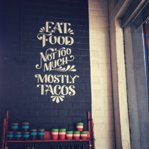 Wall painting: Eat Food, Not Too Much, Mostly Tacos