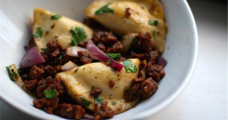 Potato, Spinach & Green Onion Pierogis with Vegan Chorizo & Onions