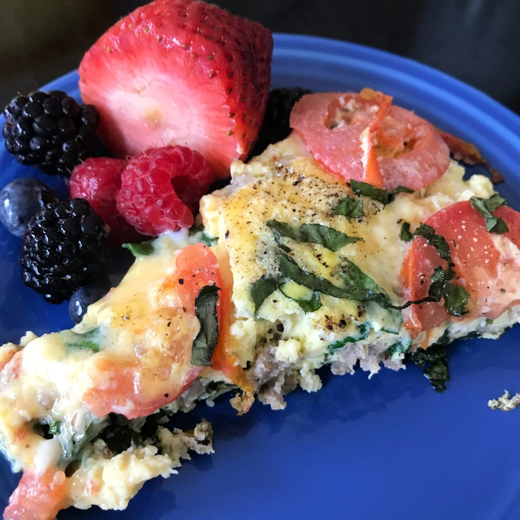 Sausage Spinach Tomato Frittata Plated With Fruit