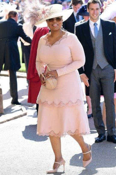 Oprah Winfrey wearing Stella McCartney and a Phillip Treacy hat.