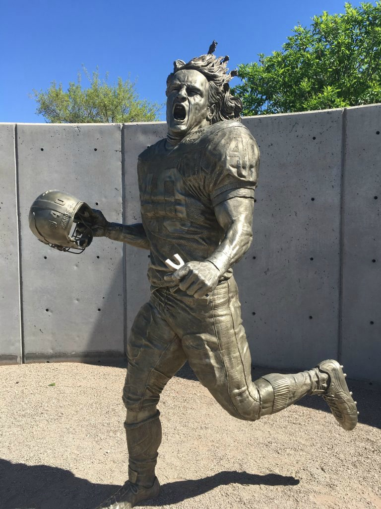 The Pat Tillman statue at State Farm Stadium is one of two memorial statues honoring the late football player. The statue is open to the public.