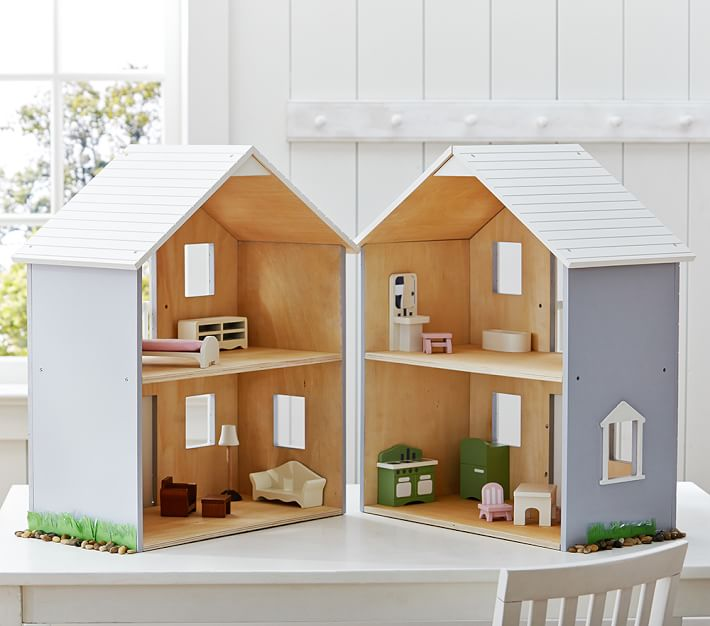 Farmington Dollhouse sold at Pottery Barn Kids is the cheapest dollhouse they sell. It's a wooden house, painted gray with white trim. The dollhouse folds open in the back, doubling the size for play. $99 #PotteryBarnKids #Dollhouses