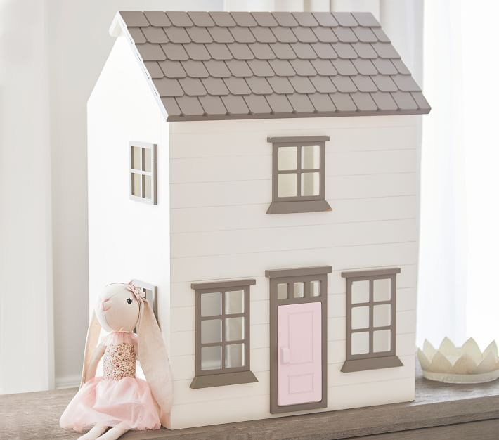 The Westport Dollhouse is sold at Pottery Barn Kids. White and gray plus it can be personalized with family name or address. Recommended for ages 3 years and older. #PotteryBarnKids #Dollhouses