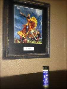 Pastor Gordon let Ryder take home the vial of oil as a reminder of God's faithfulness.  It rests on a shelf in his room, near this awesome print of a Mighty Warrior... just like Ryder.