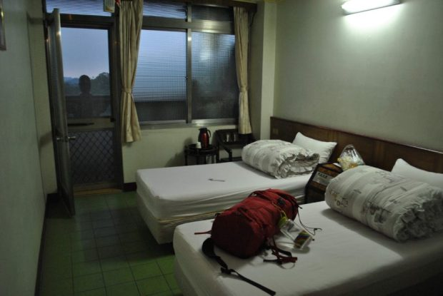 a room with two beds and a balcony at Chuan Hua Hall, Lion's Head Mountain