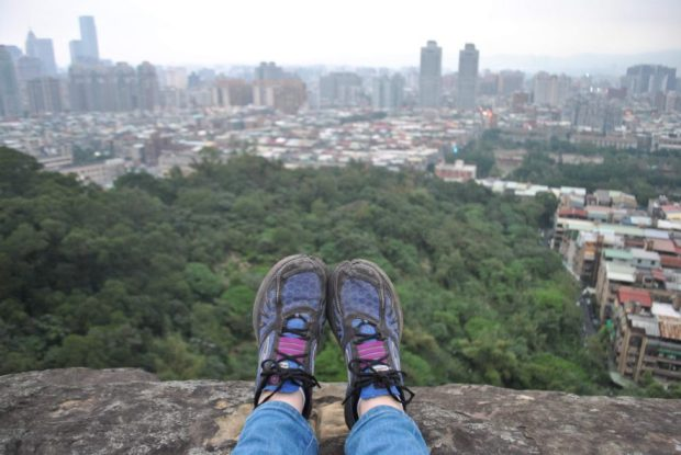 my shoes on the edge of a rock on Elephant Mountain Viewpoint, Taipei