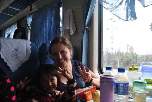Some people are pretty keen to have their photo taken, especially if you're in it with them. On the train, China.