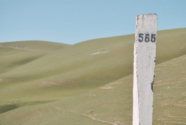 They'll speed by, they'll crawl by, but regardless they're usually marked - kilometre signage in Kyrgyzstan. Is that a 585 or a 583?