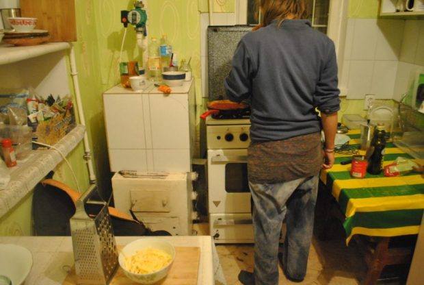 Ilona taught me lessons in thrift I didn't even know I wanted to learn. This picture says it all: Cooking at Warmshowers, in pants she found in an abandoned building in China.