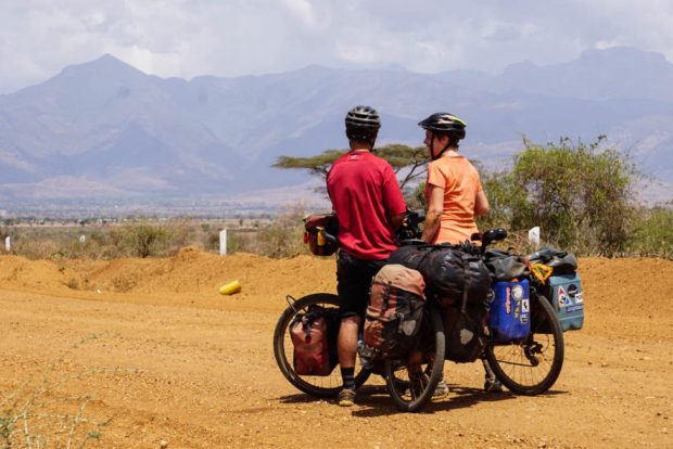 Me and Evan on loaded touring bicycles outside Moroto, Karamoja, Uganda