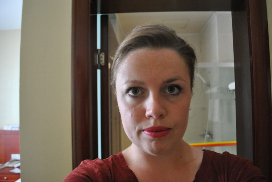 Me with lipstick in a hotel room in Dunhuang, China