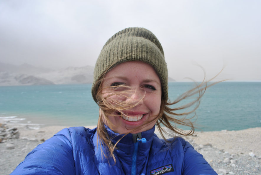 Me with a blue lake on the Karakoram Highway, my hair in the wind