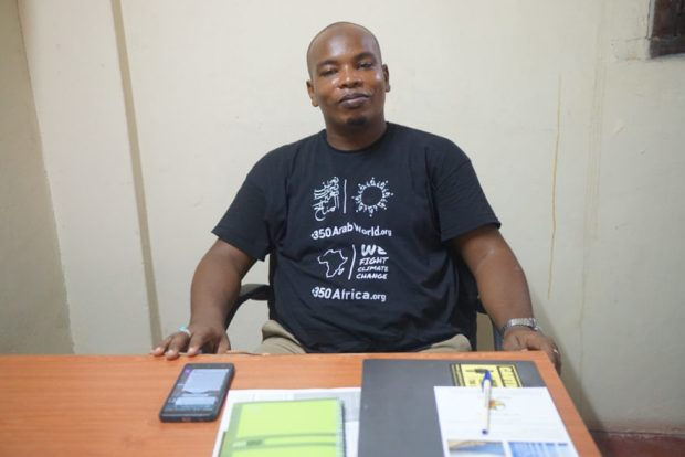 Walid an activist at Save Lamu sits at his desk in Lamu Kenya