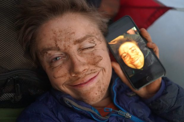 me in the tent with dirt smeared over my face because of the dusty roads on the Mau Escarpment, Kenya