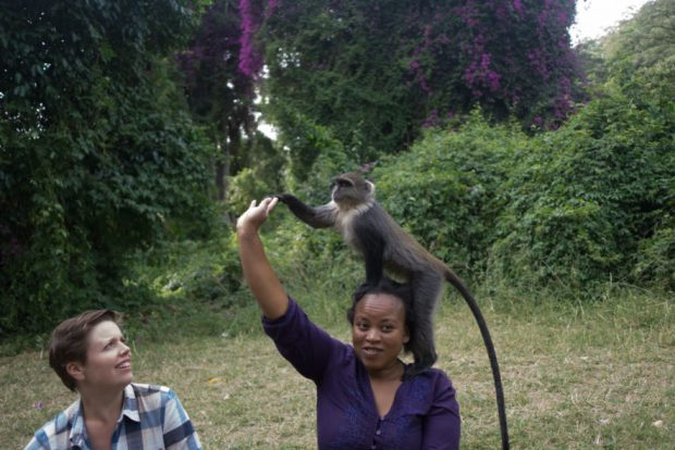 me looking at Amina at City Park, Nairobi as she feeds a monkey on her head