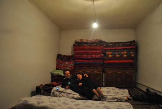 me and Evan hugging on mattresses on the floor of a home in Kyrgyzstan