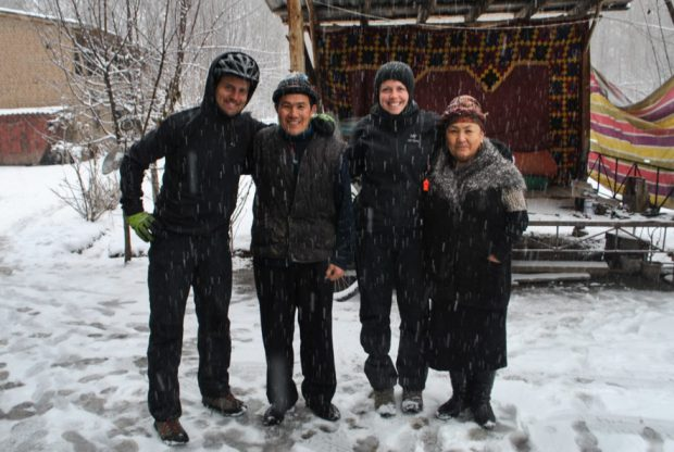near Osh, Kyrgyzstan in the snow outside the home of a Kyrgyz man and his wife in warm clothes