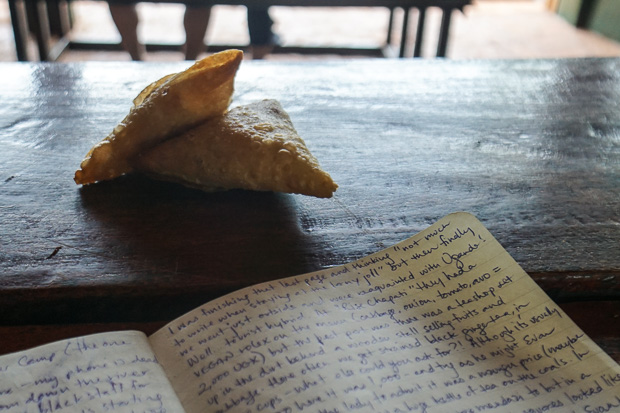 two small chickpea samosas sitting beside my open journal