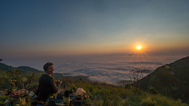 Me at our campspot at sunset over the clouds in the valley below Kitulo Plateau National Park