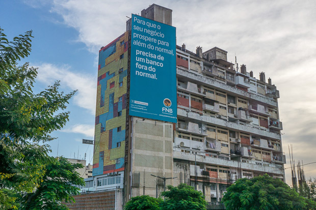a colourful apartment building with an advertisement in Portuguese, Maputo Mozambique