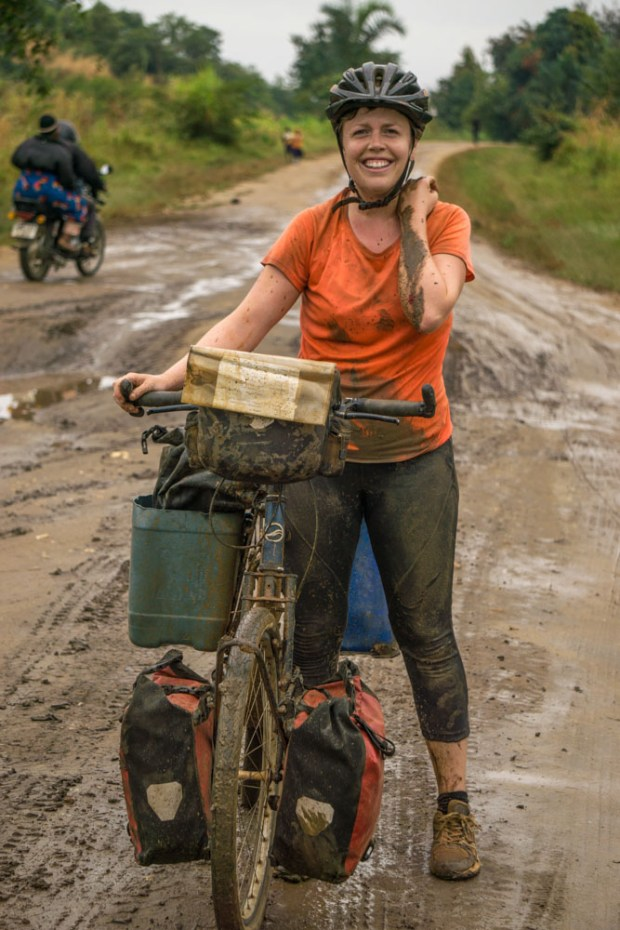 getting up after a fall while bike travelling on a muddy road in central Tanzania