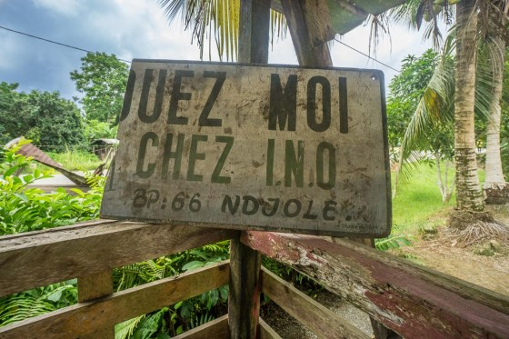 A sign for Chez INO in rural Gabon