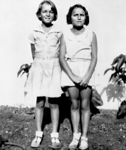 Norma Jeane (left) and a friend at the Los Angeles Orphanage in 1936.
