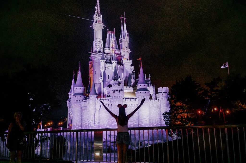 A photo of Meg in front of the Princess Castle at Magic Kingdom