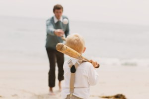 Wallace Family; Beach photos, playing in the sand; suspenders; baseball; father and son