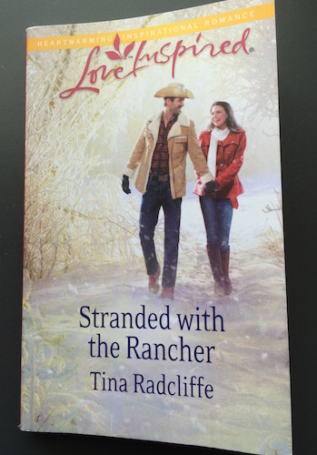 Cover of Stranded with the Rancher by Tina Radcliffe | Read the review over on MegsMinutes.com