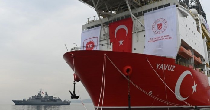 A picture taken at the port of Dilovasi, outside Istanbul, on June 20, 2019 shows the drilling ship 'Yavuz' scheduled to search for oil and gas off Cyprus, next to a warship. (Photo by BULENT KILIC/AFP via Getty Images)