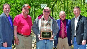Contractor George Thomas receives a plaque after restoring the bridge.