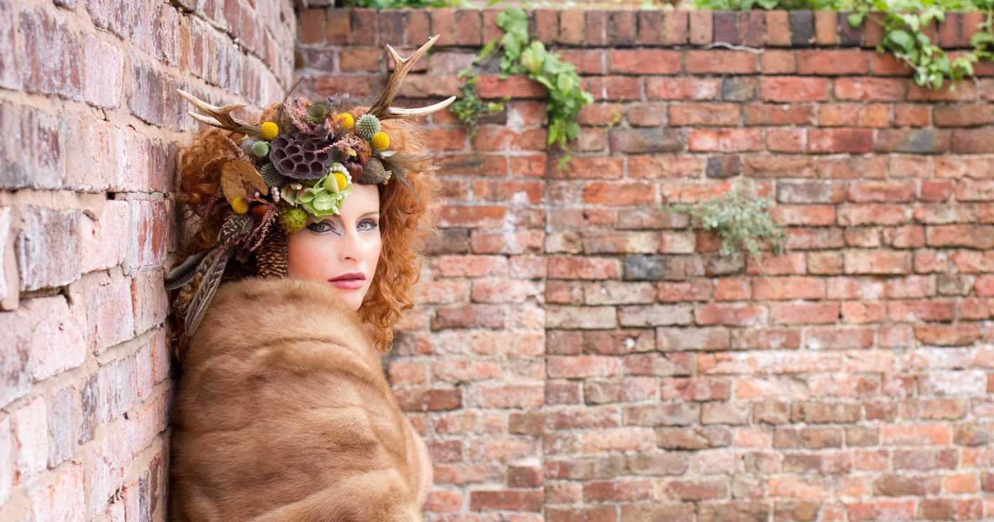Styled photo shoot. Model the antlers and a floral head dress