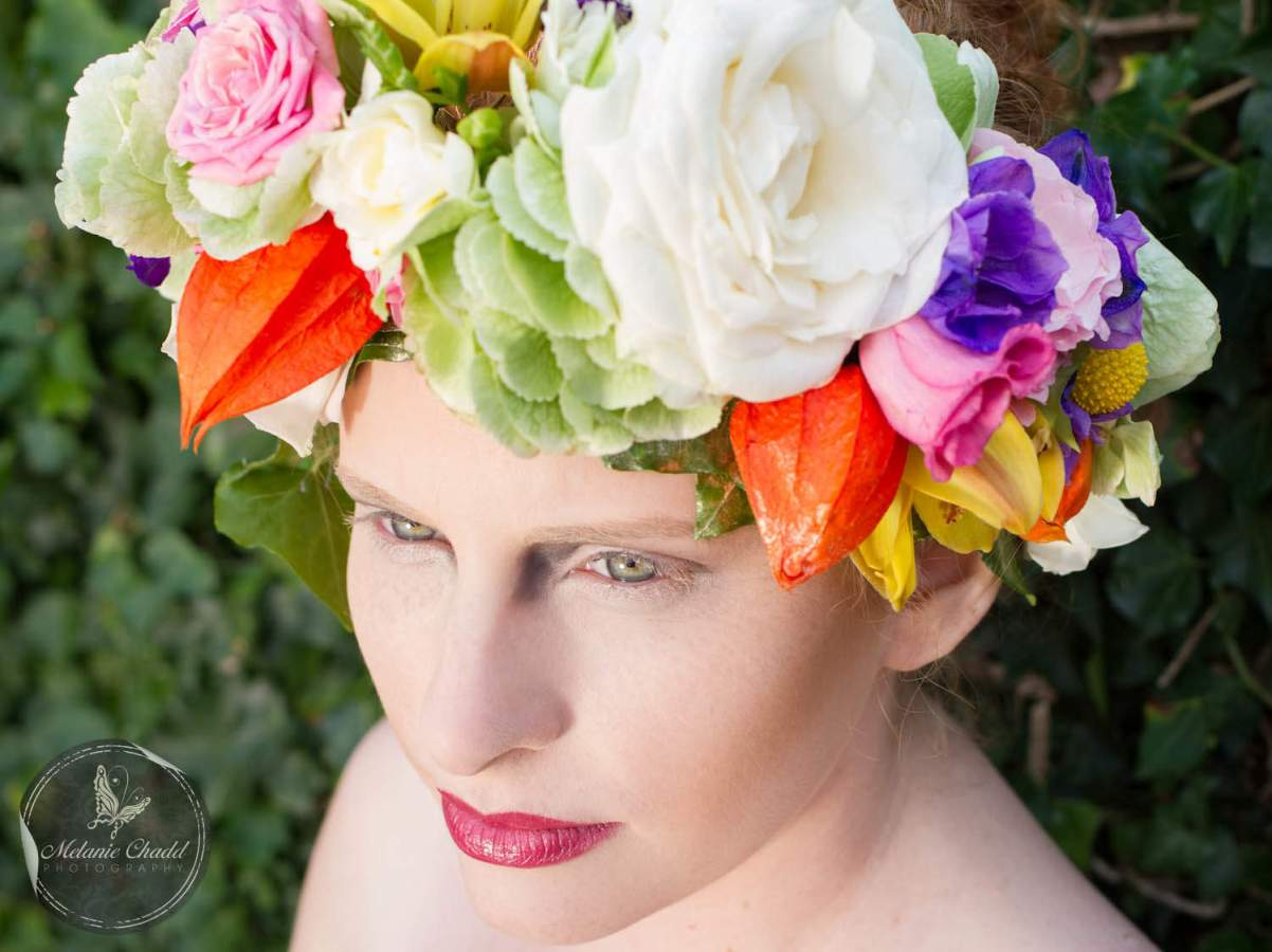 Model wearing oversized floral crown