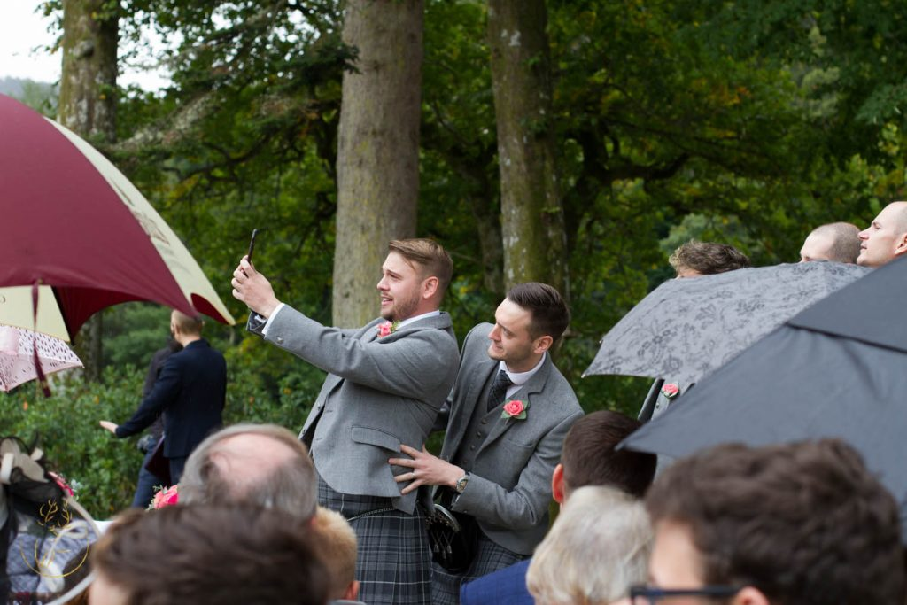 Wedding ceremony outside at Dunkeld House Hotel, Perthshire