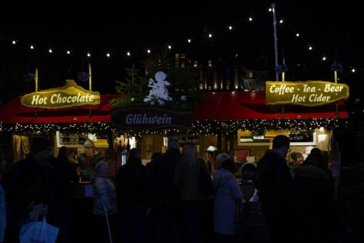Photo of people queuing at for hot drinks at the Christmas Market