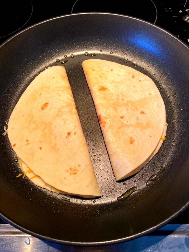 quesadillas cooking on a frying pan