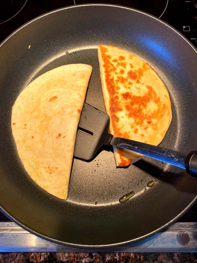 flipping cheese quesadilla